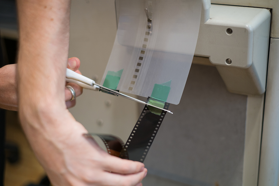 Cutting film with scissors