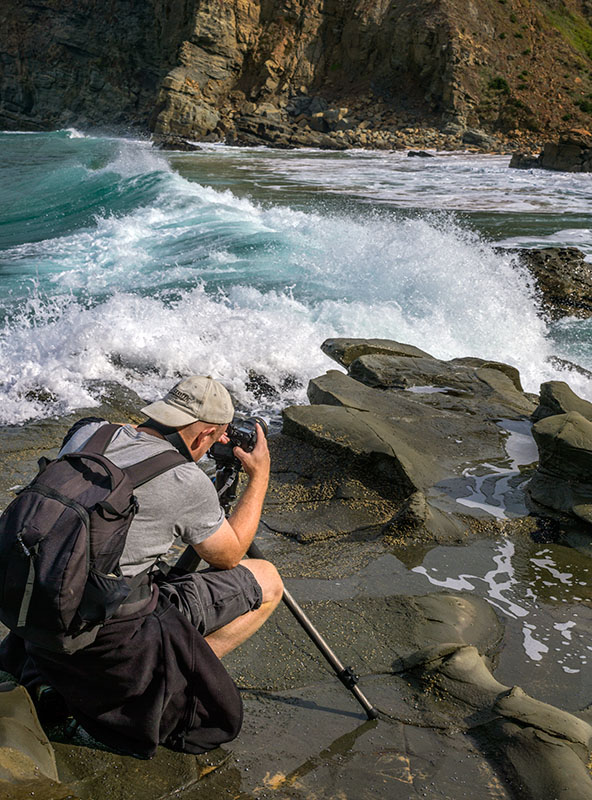 There is always the risk of a freak wave whilst shooting at the ocean. Phillip Island, Victoria, Australia. Photo of the author courtesy David Wilkinson